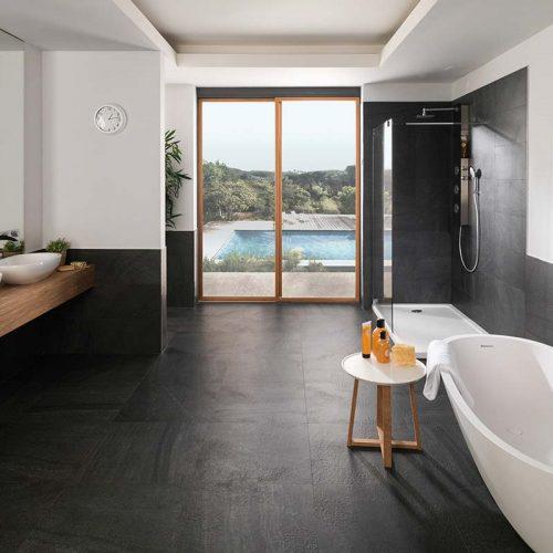 Satariano-Bathrooms-Urbatek-Modern-black-flooring-and-white-sanitry-items-with-wooden-storage-units