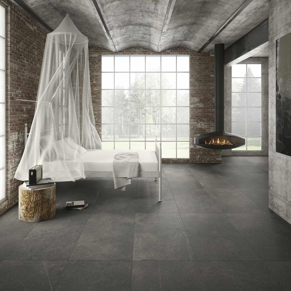 Satariano-Floors-and-Walls-Kale-grey-with-bricked-walls