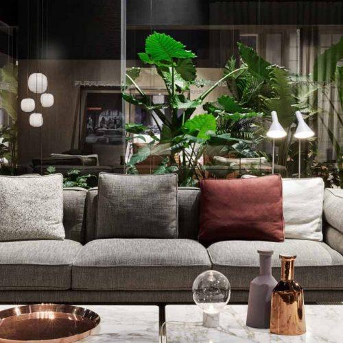 Satariano-Furniture-Flexform-Sofas-Modern-Sitting-grey-sofa-and-various-coloured-pillows