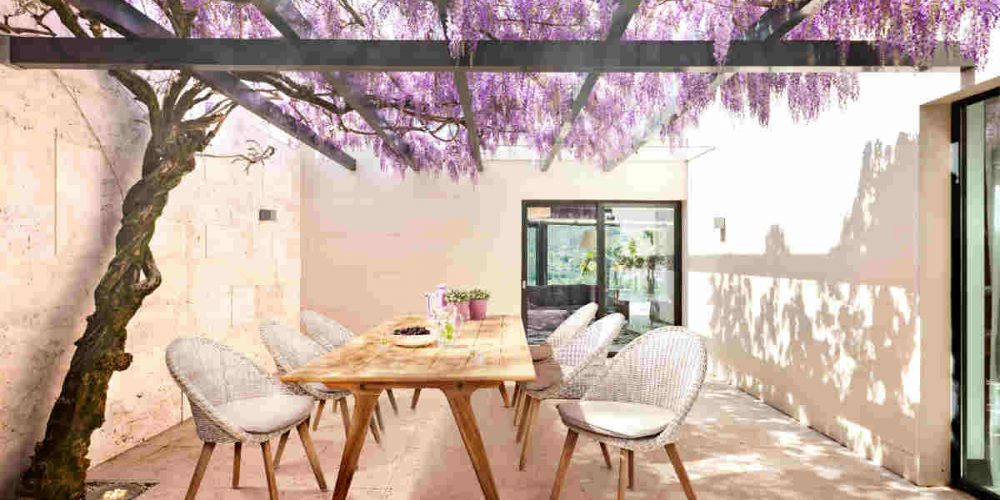 Satariano Outdoor and Spa Applebee light wood table and chairs outside