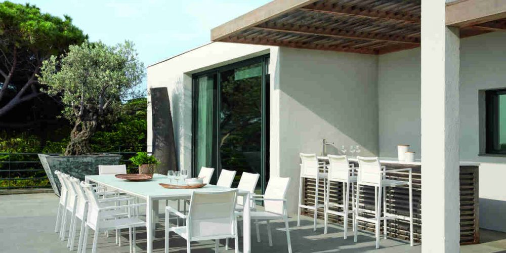 Satariano Outdoor and Spa Diphano white table and chairs outside