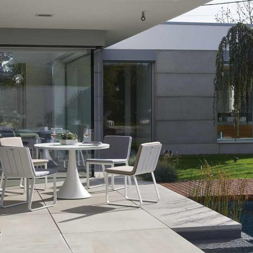 Satariano Outdoor and Spa Satariano Outdoor Furniture outside round table and chairs near pool